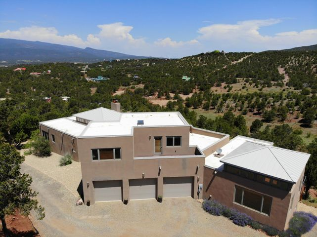 AMAZINGLY CONTEMPORARY rare Robert Caltagirone Architectural Refuge Design custom built open floor plan home with 5 acres of gorgeous picturesque views and peaceful serenity.  Contemporary home with a plethora of natural light.  Gated Community.  Wrap around deck to appreciate your views or entertain.Hardwood floors, walls of windows, chefs kitchen with 6 burner gas stove and cherry wood cabinets with stainless steel appliances.2 custom Rumford designed hand plastered fireplaces.Every bedroom has a deck.  Walkout finished basement would make a great theater room with a mini bar and fireplace.Master bedroom has it's own mini bar, Kohler heated jetted tub, custom shower, deck, huge walk in closet, and deckExterior RV parking/storage.  3 car oversized garage.