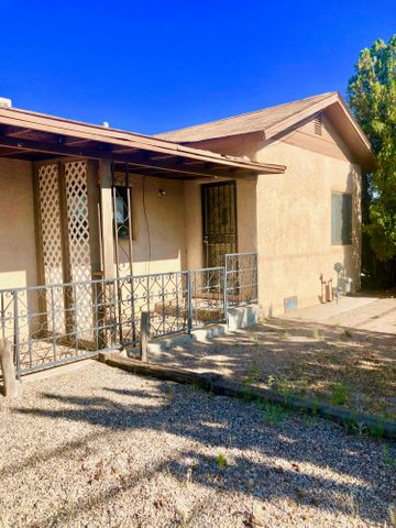 This is Cute Adobe!  Made for 2!  One half has 2 Bedrooms, Living Room and Kitchen plus a Full Bath!  The other with its own entrance is a 1 Bedroom, with Den, Kitchen and a Full Bath.  Nice corner lot.. too.  Close to everything.. and I-25 too.  Newer Anderson  Windows.  Units are also metered separately!