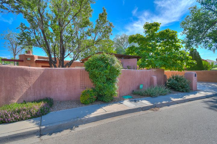 Welcome to this one of a Kind Watson Adobe home! Walk through a perfectly manicured & inviting courtyard w/fountains, covered patio & mature trees. Enter through the front door to 1,980 sq. ft. home features 2 Bedrooms with possible 3rd or study & 2 Baths. Home is finished w/original brick floors mixed in w/updated tile & wood. Remodeled Kitchen w/soft close shaker cabinets, Corian countertops, glass cooktop & double ovens. Both bathrooms are finished w/new cabinets, solid countertops & master bath has vessel sinks & oversized walk-in shower. Home has California closets throughout! Pella Windows! Refrigerated Air & Central Heating! Don't forget the backyard w/2 Covered portals, flowing fountain, access to 2 exterior storage rooms & more. Great location downtown by Tiguex Park.