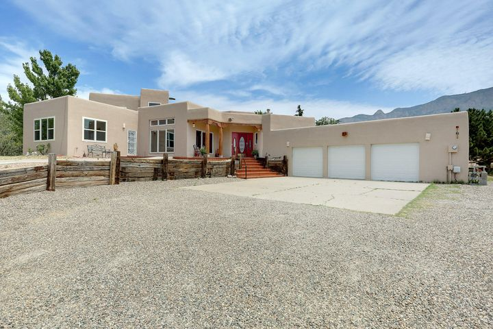 Beautiful Home in North Albuquerque Acres.  Home's finishes include granite, new paint, new carpet, recently re finished brick floors, 2 master suites, large office, bar, two covered patios with views of Sandia's.  Separate entrance for 2nd master suite.  Nice open floor plan.