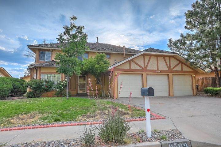 This large home is located in the desirable La Cueva district in an established neighborhood, close to shops and easy access to the main highways. Two large living areas, formal dining, breakfast nook, wet bar, and half bath downstairs. Enjoy the East mountain views from the front porch, or check out the stunning West horizon volcanoes from your private deck off the master bedroom. The lush backyard is spacious and green with many beautiful, blooming trees and bushes, and offers garden space to grow your own flowers, fruits and/or vegetables. The home has an easy flow on both levels and provides abundant space for gathering as well as private space.