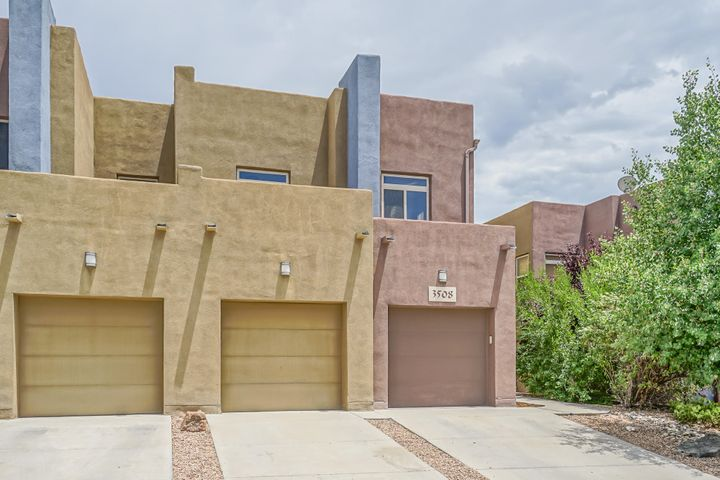 Welcome to this contemporary NE Heights Townhome.  It is FRESHLY PAINTED THROUGHOUT & has NEW CARPET. The kitchen has granite tile counter tops, maple cabinetry, island with breakfast bar, stainless steel microwave & frig, recessed lighting & pantry. It is open to the great room & dining area.  The great room has a gas log fireplace & opens out to the private back yard. All bedrooms are upstairs with a small loft at the top of the staircase. Master suite has a huge walk in closet, balcony & jetted tub. BR2 has a balcony also.The home has 2'' blinds,  skylights & arched doorways. Relax in your backyard which has 2 covered patios & a terraced area for planting. Easy access to shopping & restaurants. Fabulous VIEWS!