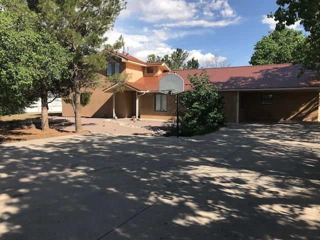 Great opportunity for a spacious home just outside the city limits of Belen!  Rural yet close to shopping, schools, churches and I-25!  30 minute commute to Albuquerque.  .75 acre fully fenced lot offers plenty of space and you will love the large mature trees that offer abundant shade.  Automatic drive gate, fully fenced yard, two storage units and a nice concrete drive way with basketball goal for your 3 on 3 tournament!  The spacious kitchen and dining areas will accommodate large gatherings easily.  This home offers two living areas and the entire home is tile floor.  Sky lights and a lot of windows make this a bright home and the refrigerated air keeps things comfortable.  The home has an above ground pool that only needs a bit of work to be your private oasis!