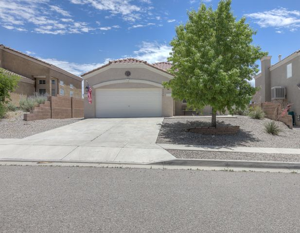 This beautiful home in north Rio Rancho is move-in ready with brand new carpet and a pre-listing inspection already done! Great features such as refrigerated A/C (3 years old), tiled roof, skylights, raised ceilings, and a master bathroom with a garden tub with a two sided fireplace and a separate enclosed shower.  The kitchen is connected with the family room and a breakfast nook with a bay window. Front & back patio (with a Sunsetter awning), epoxy flooring in garage, and tile flooring in wet areas and entryway. This home won't last long!