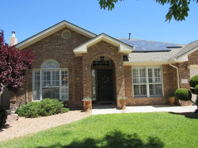 One owner brick home that has been so lovingly cared for it seems like a brand new home! New roof in 2017, kitchen appliances replaced 5 yrs ago & stay with home, water heater yrs ago, furnace approx. 5 yrs ago. 2,516 sq. ft., 3/4 bedrooms, 3 full baths, 3 car garage. Plantation shutters, ceiling fans, surround sound, intercom system, plant shelves, security doors along back, seamless steel gutters on entire house, wood burning fireplace, Kitchen has granite counters/backsplashes, microwave, gas cooktop & eat at bar. Master bath has jetted tub, separate shower, his/her sinks & large walk in closet. In ground pool & hot tub are part of this lush landscaped back yard.  Solar panels have brought owners the lowest electric bills! Cabinets in garage stay!