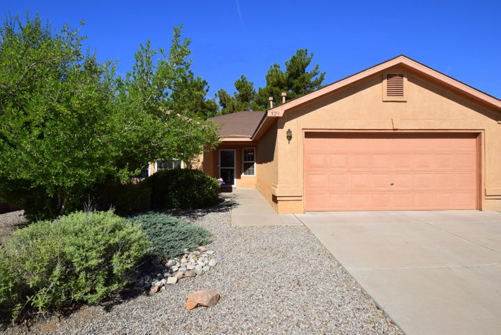 Come and see this very affordable, well taken care of  home on a quiet street in this wonderful neighborhood, This home was built with  handicap friendly amenities such as 3 foot wide doorways, zero threshold transitions from room to room  and master bathroom shower with hand rails and built in bench.  Enjoy the refrigerated air to stay cool during these warm New Mexico summer days as well. Gorgeous ceramic tile walk in shower in Master Bathroom and Eat-In Kitchen featuring built in microwave oven and electric cook top stove. This home also features a spacious living room with cozy fireplace and a beautifully landscaped yard with backyard covered porch for your outdoor enjoyment. Come and take a tour of this wonderful home.