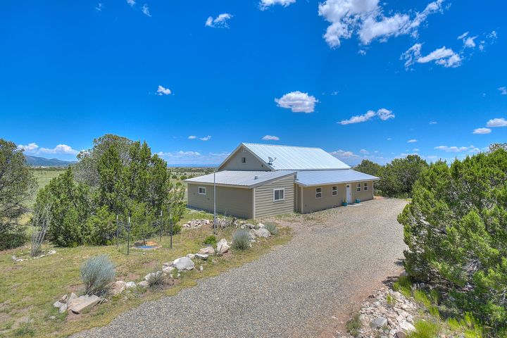 Welcome to this amazing Homestead on 5 acres with spectacular Views! This is the home for you to live on the land with your horses, cattle, goats and chickens.  Bring it All!  A spacious master that could be divided into two room along with two more bedrooms or office space.  The upstairs loft is 600 sf. extra flex space.  Open living area to the kitchen and even a service porch with an extra fridge and freezer.  Relax in the 420 sf Sunroom off the entrance with it's own pellet stove. Huge 1050 sf heated fully finished garage/shop with 240W for all of your cars and toys!  Double garage doors, one 7ft high and one 10 ft high. Horse barn and chicken coop and even a hidden school bus which was used for hay and grain storage.  So many great qualities to mention....Schedule your showing Today!