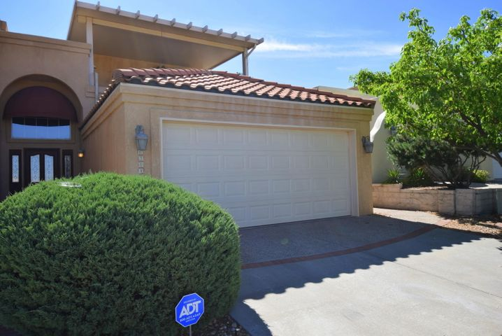 Guard gated subdivision that is nestled next to the Tanoan golf course.  This wonderful home has the master bedroom and full bath downstairs. The soaring ceilings give you a really open feeling in the living room.  On the main floor there is a powder room bath for guests.   Upstairs has two bedrooms and full bath plus a loft area that currently  is being used for a sitting area/study.  There are two decks that have wonderful views with Radar Awnings that give you lots of shade and protection from our sun!  Come join Tanaon country club for golf, tennis and a beautiful pool for those really hot days!