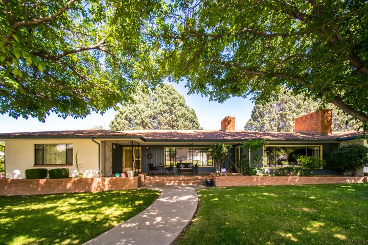 Perfectly situated on a large corner lot facing ''twin parks'' this ranch style home offers a fabulous location. This property offers a flexible floor plan including 5 bedrooms, expansive great room, large family room, formal dining and office. Custom built in bookcases & fireplaces add to the charm. New en suite master bath completed in 2019. New tile and paint added to east wing in 2018. Newer roof, gas stove, refrigerator,4th bath remodeled, washer & dryer. A GREAT opportunity to make this home your dream home! Sellers are motivated and ready to consider offers!