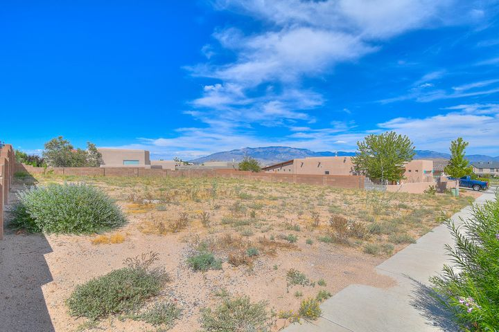 Enjoy spectacular Sandia Mountain views from your oversized 81' by 105' lot in this highly desirable Knolls Neighborhood!  Large enough to build a home with side parking and/or backyard access! No Home Owner's Association! Close to everything - Costco, Target, Cottonwood Mall with hundreds of shops, restaurants and services. Just a few minutes to access Paseo Del Norte; 15-20 minutes to Sunport International Airport. Utilities are at the lines. This is one of the last and more desirable lots left in this highly sought after community!