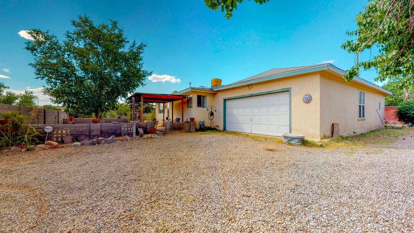 Vintage Corrales Opportunity! 2-3 bedroom true Adobe brick single story with attached studio spaces. So much potential! This little oasis boasts rustic Pine flooring in the kitchen, a great room floor plan. Mature Trees, Apricot tree, grape vines, holly, roses. Even bees in the eves to pollinate your garden. Yes you read that right! A great place to garden and relax or keep your horses or goats or chickens. The adobe bricks used to build this sweet casa were made on site around 1970. Current heating to house is the gas Lopi stove in the great room. The bedrooms used to have electric wall heaters; the gas stub is still present in one and the