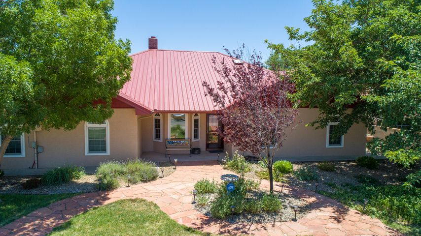PRIDE OF OWNERSHIP & no HOA fees! Facebook Data Center, Lowes, HomeDepot, restaurants, movie theater, Los Lunas High School are only a few of the businesses/schools located close to this beauty! Be sure to see this updated 3/4 bedroom, 2 1/2 bath home. Spacious .33 fully landscaped lot with a one story ranch style home. Backyard parking on the north side of the house & an attached two car garage with more storage. Windows installed in 2011 (except for sunroom), pro-panel roof, refrigerated A/C, furnace & water heater replaced in 2012, tiled flooring, new stainless steel kitchen appliances, refinished cabinets, solid wood cabinet door fronts, recessed lighting, gas fireplace with stone resurfacing, interior paint, Elastomer paint on exterior stucco updated in 2017. New skylights in 2019.