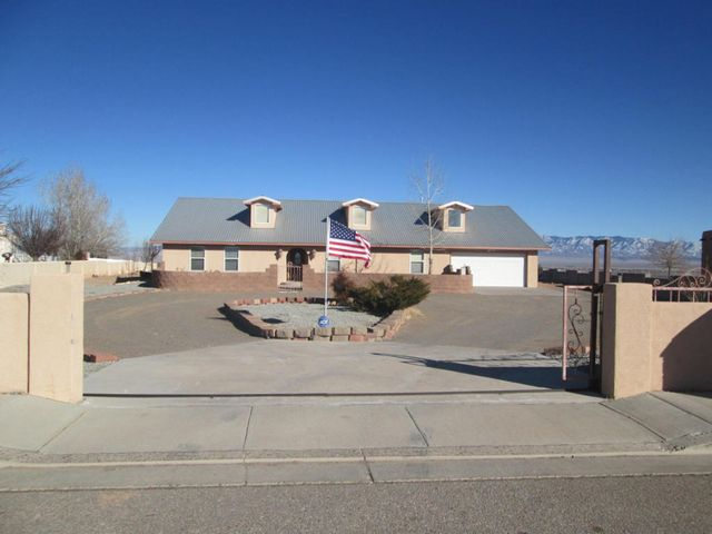Gorgeous home on a full acre with breathtaking panoramic views!  This home sits on the West Mesa Bluffs in an exclusive community of custom homes.  Features include 2 living areas and a beautiful ceramic tile & wood flooring throughout. Big 4th bedroom could be a game room or office.  Large country kitchen with Avonite counter tops, breakfast bar & large center island. Fabulous formal dining room with wet bar is great for entertaining. Master Suite is spacious with French doors leading t covered patio. Master bath with spa jetted tub & separate shower. Relax or entertain on the huge covered patio & front courtyard. Metal roof, refrigerated air, security system, new carpet. Come see this unique custom home today!