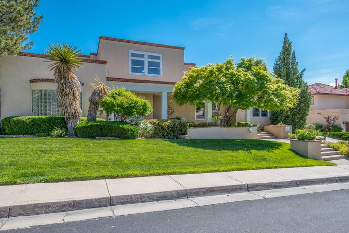 Beautifully landscaped & well maintained Tanoan home in mint condition. Remodeled powder & master baths in 2017/ 2018, new roof & all new clear skylights in 2017. Repainted synthetic stucco 2018, newer 2 unit HVAC combo unit for heat & Refrigerated AC, plus radiant under slab heat. Enter adramatic, sunlit, 2-story foyer surrounded with clerestory windows. Living room features tall, east windows and open to formal dining room w/ atrium door to sidepatio.. Open kitchen & family room have tongue & groove wood ceiling. Kitchen has large center island w/ Wolf cooktop & downdraft vent,. Appliances also incl. Wolfovens & Subzero wine cooler. Kitchen has eat-in area, plus breakfast bar. Walk-in pantry & dish pantry, plus pull out cabinet shelves & appliance. garages. SEE MORE REMARKS