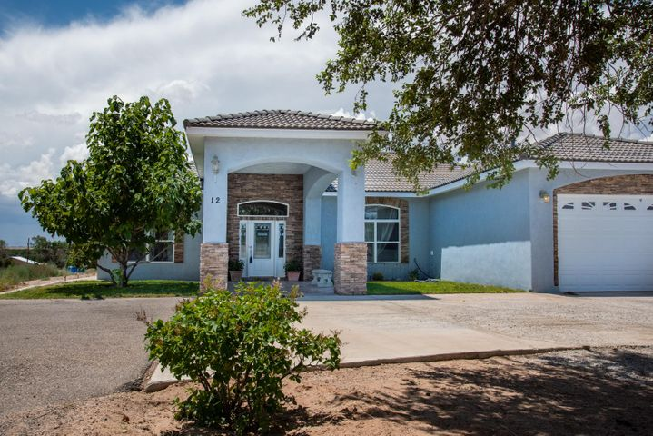 Beautiful custom built home with granite counter tops, Travertine tile, new marble back splash, Faux finished walls, Stone Veneer fire place and Exterior. Mater bath has Jetted Jacuzzi bath tub with separate large shower with dual shower heads, his her separate vanity sinks. A new water softener, Accent Lighting feature in living area, Double walk in closets, 10' ceilings throughout entire house vaulted 12' tongue and grove wood ceiling in living area, outdoor patio entertainment area with gas grill and sink with running water. Kitchen has Stainless steel appliances. Finished Garage. Completely move in ready. Quite neighborhood. Corner lot. This home is a must see to believe property! All matching window treatments stay with home. Pool and Tractor stay with house.