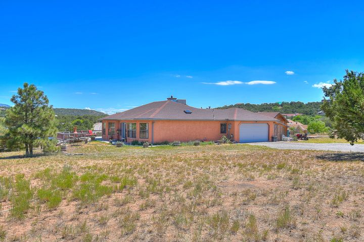 Views for days! Beautiful East Mountain home in the desirable steeplechase neighborhood in Tijeras. Just 14 min to ABQ. Bring the horses; 2 fully fenced acres with gated access. Gorgeous entry way lets in lots of light and opens up to a welcoming Kitchen with eat in area and large bay window to take in the views of the Sandias. The kitchen offers ample storage and counter space and opens up to the deck, perfect for parties. Relax and unwind in the living room with cozy wood burning stove and Zen like water feature. The 2 extra bedrooms are large and 1 has a bay window looking out onto the back patio. The Master bedroom is the ultimate escape; separate from the other bedrooms and boasting a remodeled bathroom with Tik floors! This is your ultimate mountain oasis.