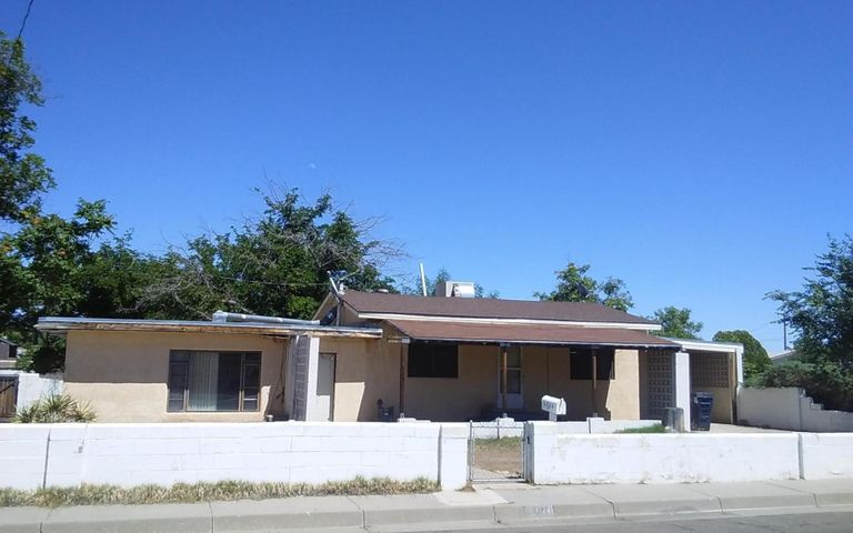 Location,Location. Centrally located in North Valley,Well established neighborhood. being Sold-AS-IS Seller will Not pay for any repairs***PRICE TO SELL***Come see this Fixer Upper, just needs remodeling and  TLC! This Home Sits On An Over-sized Corner Lot. This can Be A North Valley Gem!  Hardwood Floors And Spanish Tile. 2 Separate Entrances RV Pad.Separate Entrances