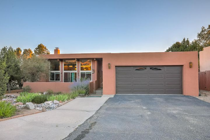 Distinctive Sandia Heights/Tramway Terrace! One Level Custom Overlooks Sandia Mountains; View Crtyard in Front & Private Bkyard w/Large Covered Patio & Entertainer's Ramada; Enjoy the Sandia & Sunset Views! Tile foyer, 4 BDRMS or 3 + office, w/ample closet space; large master w/walk-in closet & priv bath. 2 baths. Greatrm w/tile floors, raised beam ceiling, clerestory windows, slider view doors to front patio & Kiva fireplace; opens to kit & dining area. Gourmet style kit w/raised beam ceiling, skylite, fan, task lighting, updated counters, custom cabinets, pantry **Stainless appl, DW cooktop, microwave & dbl oven added 7 /19**; kit opens to greatrm, dining  area w/tile floors & rounded window. FDR & family room w/bkyd access. 2 car garage & service room. Sandia Vistas Abound!