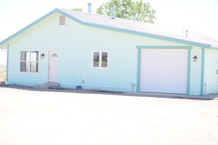 Take a look at this well maintained home set on 2.5 acres. Great property for quiet rural living but minutes away from the conveniences of the town. This home has 4 bedrooms, plus an office, 2 bathrooms, and attached 1 car garage. The rock walls inside definitely add a touch of rustic beauty! Also features a large walk-in pantry and windows that look out to the yard. Enjoy country living in this grassy yard with trees and amazing mountain views. The carpet is 3 years old, put in 2016 and the A/C was installed in 2017.