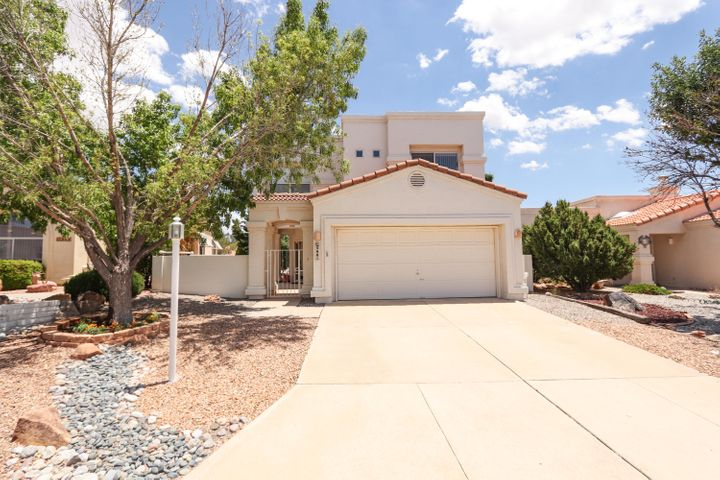 OPEN HOUSE 7/13 2:00 - 4:00 P.M.  Immaculate Move-In Ready Home Boasts an Open Floor Plan, Cathedral Ceilings, 2 Living Areas, Dining Room, Kitchen Nook and A Lot of Natural Light!  The Chef's Delight Kitchen Offers Abundant Counter and Cabinet Space, Kitchen Island, Gas Stove and Microwave!  The Master Suite Includes a Garden Tub, Separate Shower, Double Sinks, Walk-In Closet and a View Deck!  The Two Additional Bedrooms are Separate from the Master and Share a Bathroom w/ Double Sinks!  Enjoy the Views of the Sandia Mountains from the Backyard, Living Area, Kitchen and Master Bedroom!  This is a Must See!