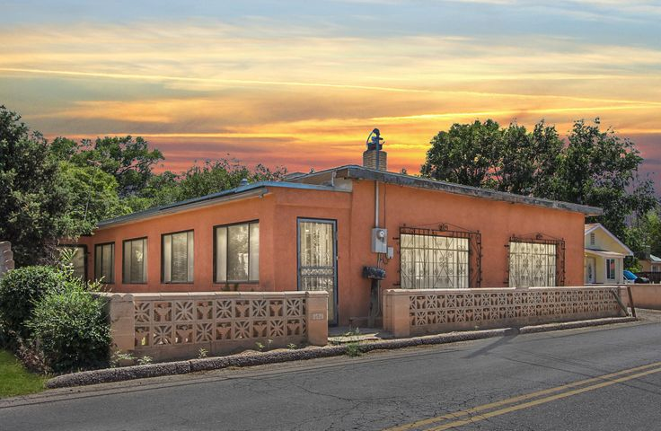 Epitome of New Mexican Architecture! Be a part of living History in this classic adobe style home located in Historic Old Town Albuquerque. Situated right off Rio Grande on Mountain Road this gem IS the Heart of Albuquerque. 4-5 bedrooms, 2+ living areas, 2 fireplaces, covered patio area large enough to act as a 4 vehicle carport, detached 3 car garage with extra storage situated on large lot, and shed are only a few of the features this amazing piece of history has to offer. Close to Old Town Plaza, I40, Bio Park, local museums, parks, golfing at country club and shopping unique to downtown. Your own piece of history awaits. Schedule a showing today before the opportunity is lost.