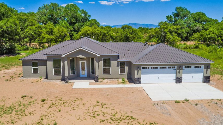 Welcome to this stunning 4 bedroom, 2 bathroom home situated on 1.78 acres. This property backs up to the beautiful Rio Grande River. The large picture windows let in lots of natural light. As you walk in you'll notice the souring ceiling. The spacious living room is complete with a gas log fireplace. The kitchen is a chefs dream and features granite counter tops and plenty of storage options. The master bedroom is roomy. The master bathroom features double sinks, a garden tub, separate shower and a generously sized master closet. The split floor plan is great for privacy. You'll enjoy entertaining on the back covered patio. There is plenty of space in the 3 car finished garage with additional storage. This home will be complete soon and ready for you! Schedule your appointment today!