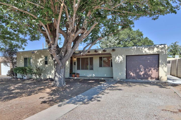 REMODELED AND UPDATED HOME 3 BEDROOMS 2 BATHS,1 CAR GARAGE,2 LIVING AREAS,WOOD BURNING FIRE PLACE,IN VERY CLOSE PROXIMITY TO UPTOWN AND UNM,GRANITE COUNTER TOPS IN KITCHEN,HARDWOOD FLOORS THROUGH OUT THE HOUSE,UPDATED AND REMODELED BATHS ,LARGE KITCHEN,STAINLESS STEEL APPLIANCES,NEW LIGHT FIXTURES,BUILT IN BOOK CASES ,,PANTRY,PATIO CONCRETED  BACK YARD,NEW ROOF IN FEB,4-5 YRS OLD FURNACE,3 YR OLD AC,WILL BE LANDSCAPED WITH NEW STUCCO COLOR