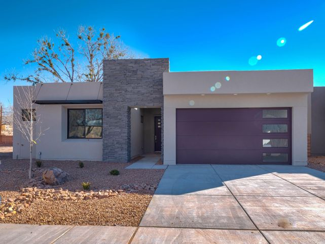 Incredible new construction in small gated community at the end of Campbell Road west of Rio Grande Blvd. Easy access to Bosque walking and biking trails. Close to Rio Grande Nature Center, Old Town, Downtown, Freeway access. This home has two master suites, one downstairs and one upstairs. Each also have their own living areas. Upstairs has unique indoor / outdoor living under a covered deck. High end custom finishes including quartz counters, hand finished walls, Bosch Appliances, Pella wood windows, custom 8' foot doors...