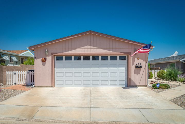 Nice Karsten, 3BR, 2BA Home in the 55+ Community of Sunrise Bluffs in Belen!!  This 1719SF home has New Carpeting throughout-June 2019 and the roof is being replaced soon! There is also a new microwave 7/11. There are so many nice features including a light/bright kitchen with skylight, large kitchen island, dining area, gas range, pantry, laundry room has a large mud sink!  Master bath has a large garden tub and separate shower, walk-in-closet!  Garage is over-sized and deep so you can easily park a large vehicle!  The home also has solar tubes and skylights, outdoor solar lights, REF AIR, beautiful raised garden with drip system. Weber grill stays!  The clubhouse has an indoor pool, gym and there are daily activities! This gated community is conveniently located off I-25!