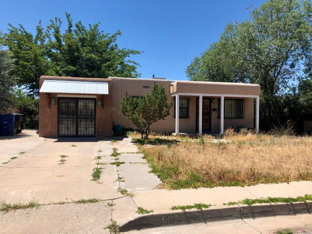 Opportunity Awaits for this 2 Bedroom Home in the UNM South neighborhood! Great-room with hardwood floors. Kitchen with endless possibilities. Property needs a little TLC. Property is being sold AS IS. Close to shopping, schools and easy access to I-40. All offers subject to short sale approval - please allow time for approval.