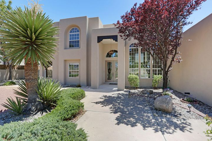 OUTSTANDING Beautifully Redesigned, Southwest Modern DREAM HOME w Spectacular VIEWS!  Your breath will be taken away as you entry thru 8 foot double doors, Open concept living at its finest!  Soaring 20 foot ceilings in Dining room & Great Room w designer fireplace, wall of windows w New remote controlled shades.  New Gourmet kit w island, self-closing cabinets, Quarts counter tops, Kitchen Aide appliances, Gas slide-in range w pop-up venting, Fridge, dishwasher, micro.  2 master suites, one upstairs & one downstairs.  Upstairs master w gas fp.  3 car oversized garage w oversized doors.  89 acre lot w backyard access, outdoor fireplace & 5 patios for enjoying VIEWS, Relaxing & Playing! List of NEW: refrigerated air, TPO roof w warranty (5 yr.), stucco, flooring, tile, carpet, lighting ++
