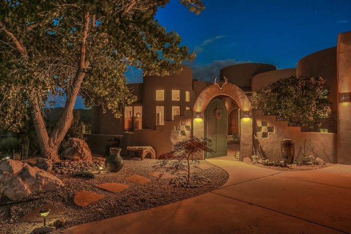 COMFORT AND LUXURY -- Surrounded by immaculately manicured grounds on 3 acres, this stellar residence was thoughtfully designed for both indoor and outdoor living and entertaining. Featuring 4 bedrooms, a dedicated office, 5 baths and 5-car garage, 2 living spaces and incredible views, there is nothing in all of Albuquerque that matches the quality, privacy and architecture of this amazing home. Located in the coveted golf-course community of Paa-Ko, your lifestyle will be immensely enhanced with star gazing from the bubbly hot tub or sitting on the covered patio. What a wonderful way to wind down your day! You've worked hard for this lifestyle -- come and enjoy. You're Home!