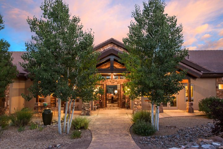 Parade of Homes GOLD Winner!  Priced well below replacement quote from original builder. Spectacular  Views from this  Private Captivating Contemporary Home! Well-Designed Living Spaces - 3 Bedrooms, Theater Room w wet bar, Study, Climate Controlled Wine Room, Huge Living/Dining Area 27' Soaring Ceiling, Solar Panels, Dream Kitchen - Earnest Thomas Cabinets, Concrete Floors, Refrigerated Air, Oversized 3 Car Garage, Mud Room, Massive T n G covered Patio overlooking the course's Hole #1. Great for entertaining & star gazing! Spa/Pool = Spool Outdoor kitchen with Wolf appliances! Private Gated Area in Fabulous Paa-ko with Natural Gas and, Community Water! A few social happenings -Bunco, Book Clubs, Pool, Tennis, Golfing, Garden Club, nearby Community Center offers a great work out facility.