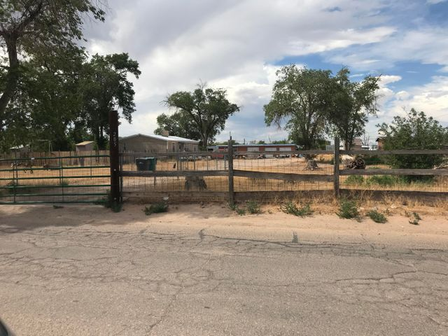 Bring the horses and your hobbies too! This one owner, 3 bedroom 2 bath doublewide sits in a  fully fenced 1.21 acre  property that has a 2 stall barn, separate 2 car garage with a huge attached workshop, 2 nice sized sheds, and fruit trees.