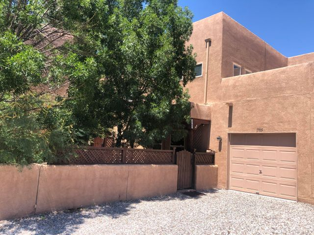 SELLER FINANCING! Carpet Credit!! BRING A BUYER TODAY!!Beautiful 3 bedroom 2 bathroom Townhome nestled right next to old town.  The neighborhood is amazing and the little parks all around make it feel cozy and homey.  This particular unit has a loft above the kitchen which is the ONLY unit that has it.  Newer stainless steel appliances and Washer/Dryer that DO convey.  The one car garage keeps you car out of the hot sun and the personal courtyard is big enough for bbqing and enjoying the cool New Mexico evenings.  Refrigerated air and a water softener in the Laundry Closet.The only thing the house needs is new carpet, bring you buyers by and we can get this deal rolling!