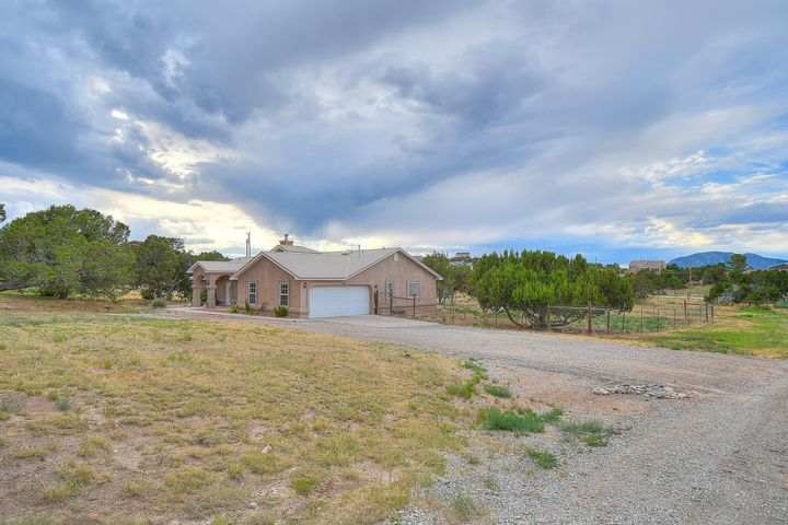 Gorgeous Northern NM home in the heart of the East Mountains. Tucked in the trees for privacy but close to comforts of shopping, restaurants, Walmart and more. Just 16 min to ABQ! huge dormer windows and lots of light. The fire place is the true focal point in the family room built for game night! Large kitchen with bar and breakfast nook as well as a full dining room. The master bedroom is on a split floor plan with its on private entry to the patio. Large walk in closet and double sinks! Unwind in the jetted soaking tub separate from the shower. 2 extra bedrooms offer maple closet space and room to grow. Metal roof and refrigerated air! An oversized laundry room may actually make you want to do laundry..maybe! Come see this beauty today and make yourself at home.