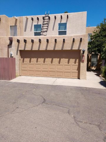 Charming townhome in great location. Beautiful laminate wood flooring, updated Kitchen with stainless steel appliances, updated bathrooms. Quaint back courtyard with no one behind only view of open area and swimming pool plus plenty of room for BBQ's. Mstr bath has two sinks, Built ins upstairs and Office/possible fourth bedroomHOA includes water & waste