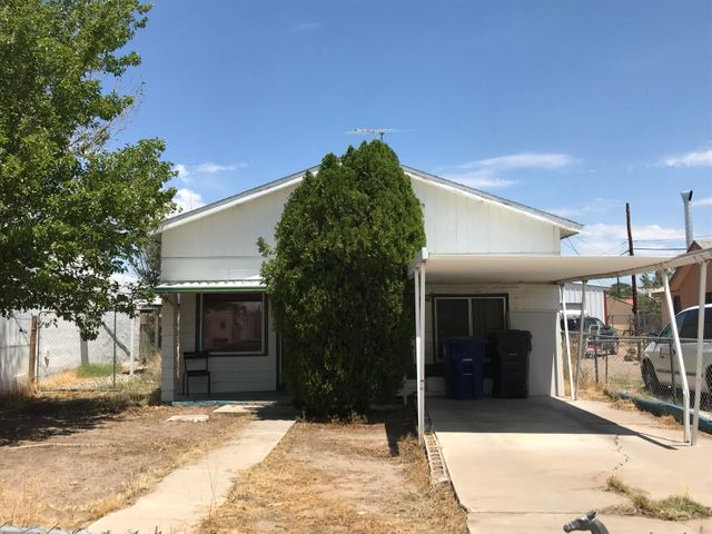 PHOTOS AND VIRTUAL TOUR COMING SOON.  Conveniently located,  2 bedroom, 1 bath home with open kitchen, covered patio and OVERSIZED backyard. Home needs some TLC,  Call listing agent at 505-720-4105 for details. You won't want to miss this great opportunity.