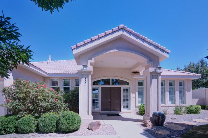 An incredible opportunity to get into one of Albuquerque's most desired neighborhoods at a great price!Premium single level 4 BD, 3 CG home in Primrose comfortably sitting on a View lot that backs to open space.Stunning Presentation featuring plantation shutters, crown molding accents, high ceilings, skylights, recessed lights & meticulous landscaping. Spacious layout w/Formal Dining Room, 2 Living Rooms - one w/fireplace & other featuring wood floors, wainscot paneling & built-in shelving.  Kitchen features granite countertops, stainless steel appliances, breakfast bar, ample counter top space.You will love the private covered patio in backyard coupled with a built up deck to showcase the stunning Mountain Views. Plus synthetic lawn for room to play. Top Rated School Districts, Call Now!