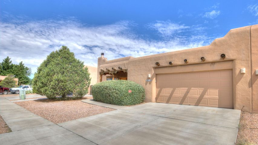 Spectacular Southwestern Custom Home Has Been Meticulously Maintained And Cared For. T&G Ceiling In Great Room With Vigas, Kiva Fireplace, Tiled Throughout Except New Carpet In Bedrooms, Laminate In Hallway. Custom Cabinets In Large Kitchen Include Pull Out Shelves, Lazy Susan And Hidden Cutting Board. Spacious owner's suite with large master bath boasting double sink, garden tub and separate shower. Backyard With Covered Patio and Mountain Views, Possible Dog Run On The Side. Freshly Painted, Clean And Ready For New Owner! Tucked away in a quiet culdesac in a convenient westside location just off Montano.