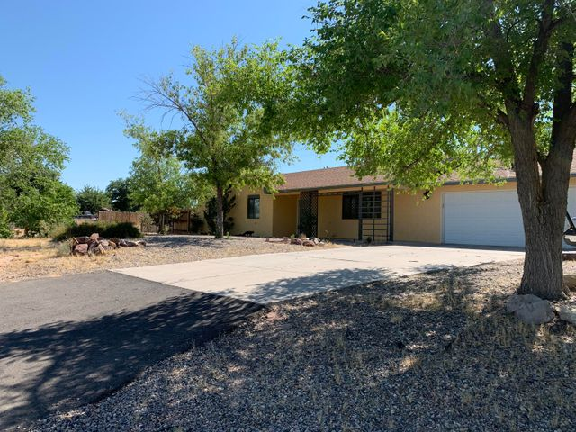 Come see this well maintained home that sits on 1/2 acre with large back yard with Back Yard access for the toys or RV.  Large covered back patio with area too sit and relax.  Spacious 3 bedrooms, dining off kitchen and 20x14 living room for the large family get togethers with a large picture window with views of the valley. Large oversized garage with extra storage room and shed in back for all the tools. Dont miss out on this one.