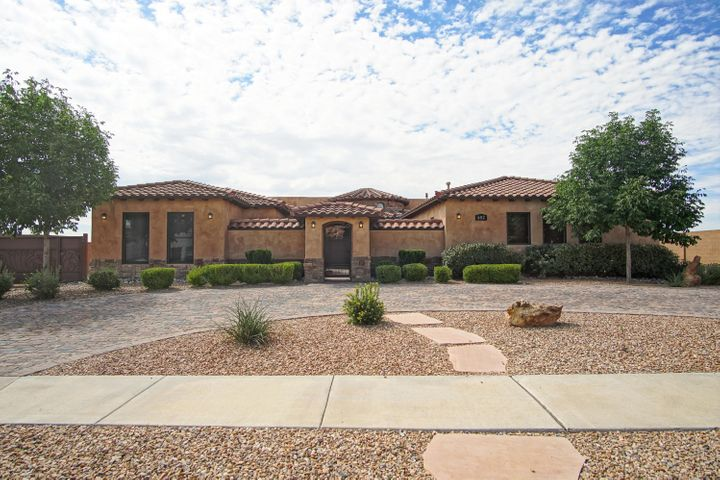 A stunning custom built Tuscan that is over-the-top amazing! An entertainer's dream.Upon entering the secured entry front courtyard you will notice the care & attention to detail evident in this fine home. Hand troweled plaster walls meet custom travertine and upgraded carpet floors. Kitchen features a professional chefs dream with commercial stove/upscale furniture grade custom cabinetry/rich granite/Wolf/Sub Zero appliances and a huge island with tons of counter space. Rec Room with wet bar/speakers. Family room and master bedroom have custom ceiling treatments/built-ins/etc.So many architectural elements make this home stand out.Exterior includes outdoor kitchen, Trex deck with custom built-in gas torches, custom stucco finish, garden area, impressive landscaping,and paver driveway/walk