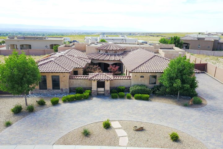 OPEN HOUSE SAT 2-5 Stunning custom built Tuscan that is over-the-top amazing! An entertainer's dream.Upon entering the secured entry front courtyard you will notice the care & attention to detail evident in this fine home. Hand troweled plaster walls meet custom travertine and upgraded carpet floors. Kitchen features a professional chefs dream with commercial stove/upscale furniture grade custom cabinetry rich granite/Wolf/Sub Zero appliances and a huge island with tons of counter space. Rec Room with wet bar/speakers. Family room and master bedroom have custom ceiling treatments/built-ins/etc.So many architectural elements make this home stand out.Exterior includes outdoor kitchen, Trex deck with custom built-in gas torches, custom stucco finish, garden area, impressive landscaping.