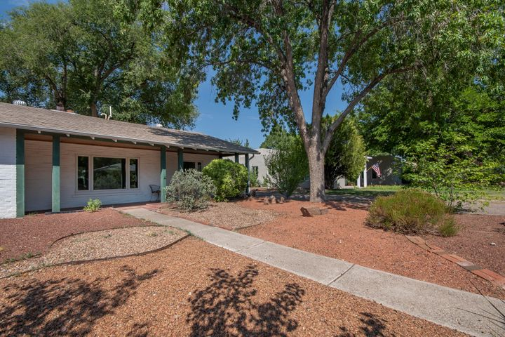 Located in the desirable Albuquerque Country Club, this quintessential  1938 design w/ casita/studio offers a wonderfully diverse configuration.  Main home features spacious rooms, 2-3 br/ 1 3/4 bath, hardwood floors, fresh paint, recent roof, recent HVAC (w/refrigerated air), updated kitchen, and beautiful aluminum clad. wood windows.  The lovely park like backyard offers a tranquil and private setting w/ covered patio and access to the casita with 3/4 bath, which could be configured into a number of lifestyles.  1 1/2 short blocks to the country club and an easy walk to Tingley Park, Old Town, downtown business and dining, galleries, theater, and some of the best biking trails in the country.