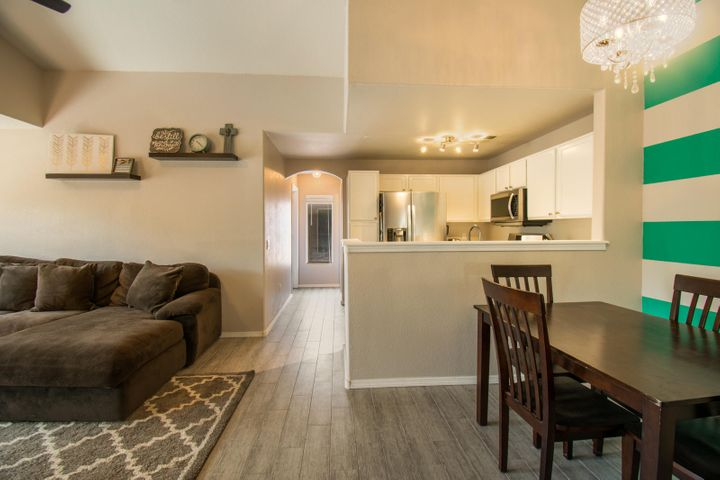 This is the one!  Welcome to this beautifully updated condominium in Academy West.  This home shows pride in ownership.  NEW paint, kitchen cabinets, kitchen counter tops, the list goes on.  All appliances stay.  Come swim or enjoy the balcony breeze at this beautiful move in ready home today.