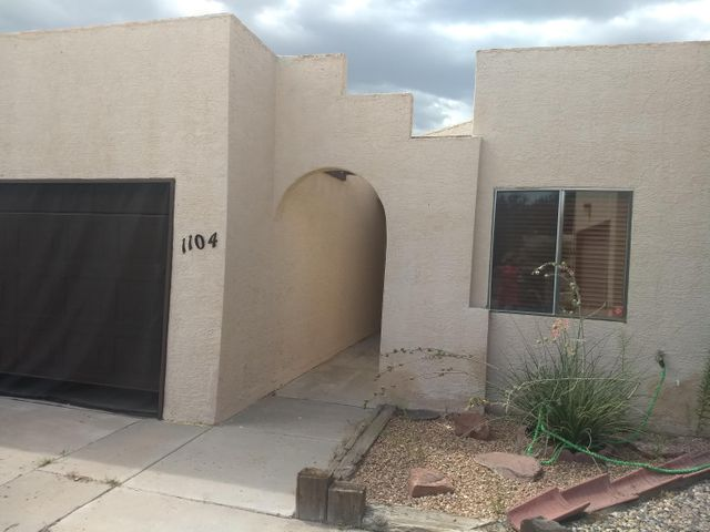 Motivated Seller!!!!!!Beautiful townhome with 3 bedrooms,  cozy sunroom and 2 full baths.  Almost new upgraded  Stainless steal appliances that includes stove, dishwasher, refrigerator. pantry, and Dining area.  Fireplace in grand living room with high ceilings and tile floors. Very functional floor plan with separated bedrooms from the   Master bedroom with 2 large his and her closets and full bath.  Sunny and bright, well maintained with skylights.  Golf course view from the backyard.  Easy to maintain landscaping, very private neighborhood with 2  car garage attached. Golf course community, no HOA dues!! Beautiful area