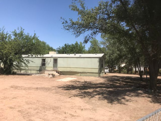 Manufactured home on fenced .5 acre lot with detached 2 car garage in Lake View Acres. Close to amenities and shops. City water and gas. Home ''as is'' and needs work but could be great for a first time home buyer or investor. Seller will entertain owner financing at full asking price with 10% down, amortized at 6% over 10 years. White Mazda truck does not convey.