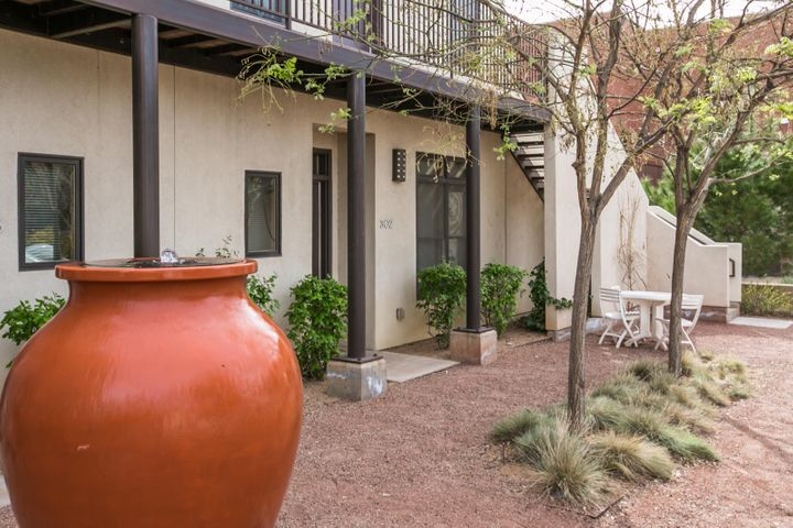 * Incredible Location! Quaint and intimate condo in the heart of downtown Albuquerque. Offering BRAND NEW (completed 2019), raised ceilings throughout, wood flooring, stainless steel appliances in kitchen and freshly painted walls. A large master bedroom, bathroom and walk in closet will suit most buyers. Enter through your private gate into one of two courtyard areas to find beautifully landscaped grounds and a private parking space. Walking distance to all of the amenities that downtown has to offer such as, shopping, restaurants, concerts, Zoo, aquarium, botanical gardens, Rio Grande river trails, Museums and convenient freeway access. Incredible location for a quiet evening. Come see and enjoy today!
