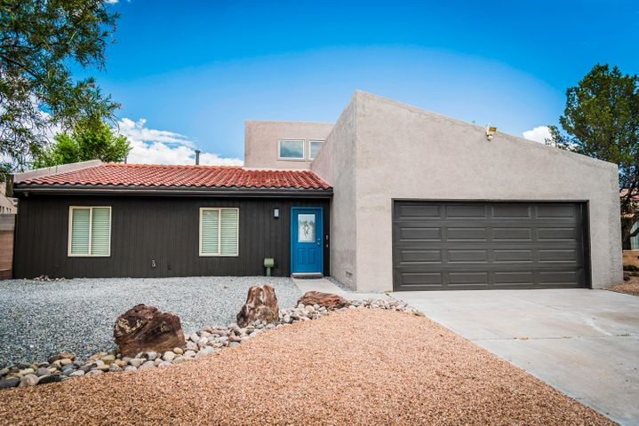 Gorgeous remodeled home.  The backyard faces the former Rio Rancho Golf course.  Spacious living room with vaulted ceiling. Natural lighting in the living room and dining room. Walk-In closet in master bedroom. New kitchen cabinets and granite countertops. Stainless steel appliances. Low maintenance xeriscape front yard.