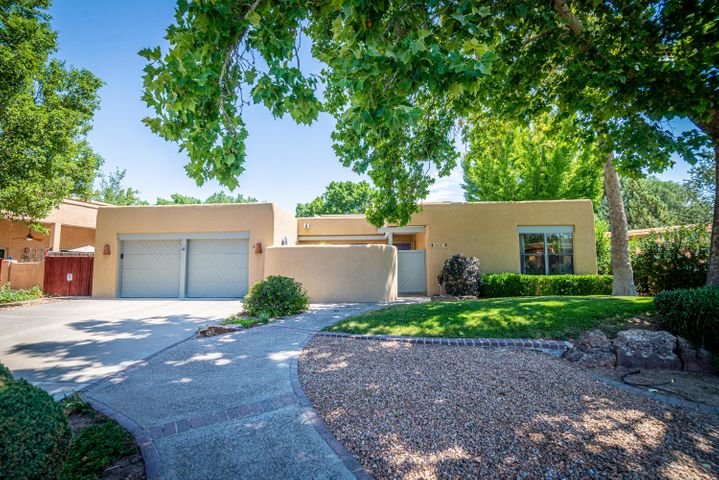 Beautiful Custom Home in Thomas Village! This Home sits on .27 lush green AC and has been lovingly cared for by its original owners since it was built in 1985!  Enter through the gated courtyard and into the main home to be greeted by a beautiful atrium with a magnificent skylight above and then to a large living room which has an award winning fireplace of its time! Home has beautiful hardwood flooring, 14 ft beam ceilings, 4 large bedrooms, a family room with a Kiva fireplace and built-in bookshelves, nice updated master bath, updated kitchen with Wolf oven and gas cooktop and nice stainless Range Hood, Sub Zero Fridge, pantry. Garage is heated with a separate thermostat-workbench stays! Home has 2X6 construction and heavy insulation. Enjoy the nice covered patio & lush, shadybackyard!